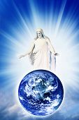Jesus Christ with blessing and loving gesture above Earth over sky with divine rays of light