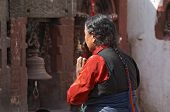 Praying woman in buddhist temple