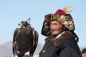 Old-man eaglehunter with golden eagle