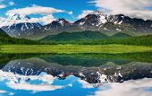 stock photo of mountain-range  - Landscape with mountain and blue sky reflected in water - JPG