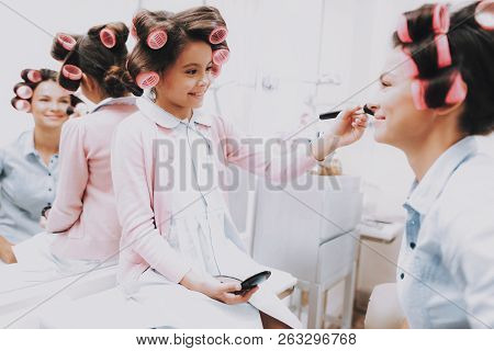 poster of Little Girl With Curlers. Beautiful Little Lady. Girl In Beauty Salon. Smiling Girl With Brush. Cons