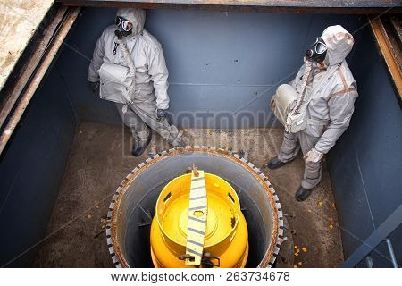Two People Dressed In Chemical
