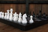 Black And White Chess Pieces On A Chess Board,pawns Staying Against Each Other On Chess Board,with S poster