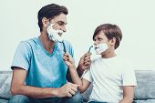 Smiling Father And Son Shaving Together At Home. Father And Son. Smiling People. Parenthood Concept. poster