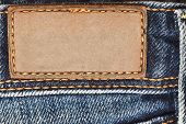 Blank leather label on blue jeans