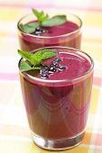 Blueberry smoothie with berries and mint leaf