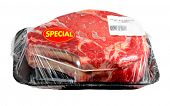 A prime rib roast packaged and wrapped in cellophane or plastic wrap.