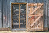 Lobster traps stored in a shed on the wharf all ready for lobster season in Prince Edward Island, Canada.