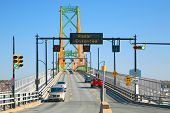 Traffic crossing the Angus L. MacDonald Bridge linking Dartmouth and Halifax, Nova Scotia, Canada.