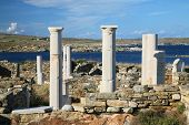 View overlooking 'Cleopatra's House' and the ruins of Delos towards the shore. The Greek island of D