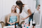 Blond Girl In Beauty Salon. Makeup In Beauty Salon. Makeup Artist With Brush. Woman And Makeup Artis poster