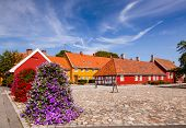 Old Stavern market square (Torvet) with red and yellow historic buildings. Stavern is a popular trav poster
