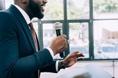 Cropped Image Of Smiling African American Speaker Talking Into Microphone During Seminar In Conferen poster