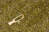 Lot Of Whole Dry Green Mung Beans With Wooden Scoop Flatlay Isolated poster