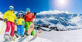 Happy family enjoying winter vacations in mountains, Val Thorens, 3 Valleys, France. Playing with sn poster