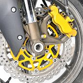 Closeup detail of a motorcycle's front wheel