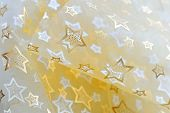 stock photo of gold glitter  - Golden stars on cloth background - JPG