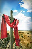 stock photo of risen  - Wooden Cross with Red Cloth - JPG