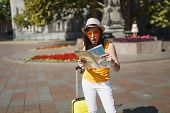 Shocked Puzzled Traveler Tourist Woman In Orange Heart Glasses With Suitcase Search Route On City Ma poster
