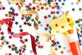 red and golden spirals, small confetti stars and yellow dotted blower on white background, party ti