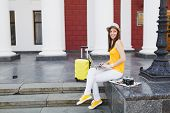 Young Pretty Traveler Tourist Woman In Hat With Suitcase Sit On Stairs Using Work On Laptop Pc Compu poster