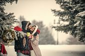 Christmas Couple Of Happy Man And Woman Drink Hot Wine. New Year Girl And Guy In Snowy Forest. Winte poster
