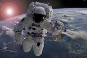 Astronaut Flying In Outer Space Near Planet Earth Doing Some Work Near Space Ship, Elements Of This  poster