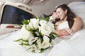 Just married joyful young couple inside limo