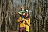 Family Hiking In Woods, Discovery Concept. Making New Discovery During Autumn Vacation Together Into poster