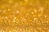 Gold Sequins Shine Bright. Yellow Powder. Glitter And Bokeh Lights. Shining Background poster