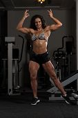 Attractive Woman Flexing Muscles poster