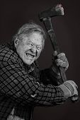 picture of gash  - Very scary crazy old man with axe great details almost completely black and white except for eyes and blood on tool - JPG
