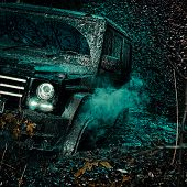 Offroad Vehicle Coming Out Of A Mud Hole Hazard. Road Adventure. Adventure Travel. Mudding Is Off-ro poster