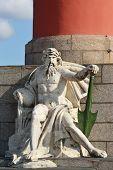 Statue at pedestal of Rostral Column in St.Petersburg