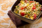 picture of quinoa  - quinoa salad with cherry tomatoes and roasted corn in brown bowl - JPG