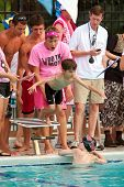 Child Swimmer Dives Into Pool During Swim Meet