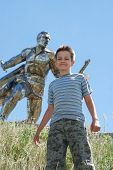 Boy Standing Against Monument Of Defender poster