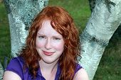 Pretty red headed woman posing for the camera