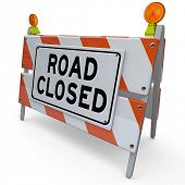 The word Road Closed on a barricade or barrier sign placed at a street or intersection to alert you to construction work