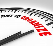 pic of neat  - The words Time to Organize on a white clock to communicate now is the moment to get things in order - JPG