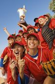 stock photo of softball  - Excited young softball team cheering after a winning game - JPG