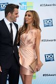 Los Angeles - AUG 19:  Bill Rancic, Giuliana Rancic arrive at the 2012 Do Something Awards at Barker