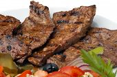 picture of liver fry  - Fried beef liver on the dish with fresh vegetables salad - JPG