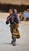 laotian hmong girl caring her little brother