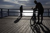 Man, Bicycle At The Pier