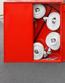 pic of firehose  - High pressure fire hose in red box - JPG