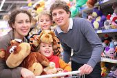 Family In Shop With Soft Toys poster