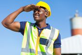 smiling african builder looking into distance
