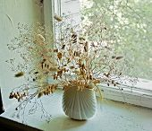 Dry Grass In The Vase On The Old Window Sill