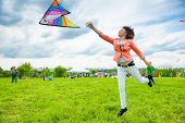 MOSCOW - MAY 25: Unidentified people fly kites at the kite festival in the park Tsaritsyno on May 25, 2013 in Moscow.